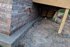 brick skirt under stairs